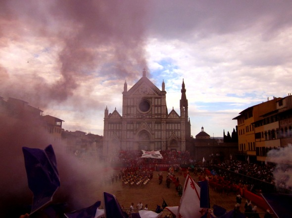 fans set off a smoke bomb in piazza santa croce to welcome their calcio storico team