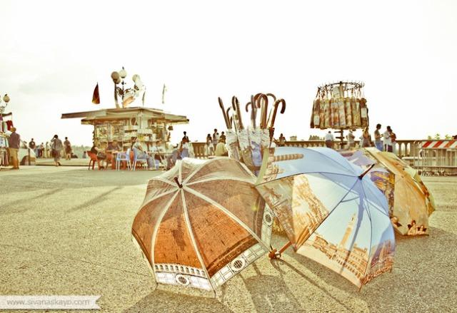 Umbrellas in Piazza Michelangelo by Sivan Askayo