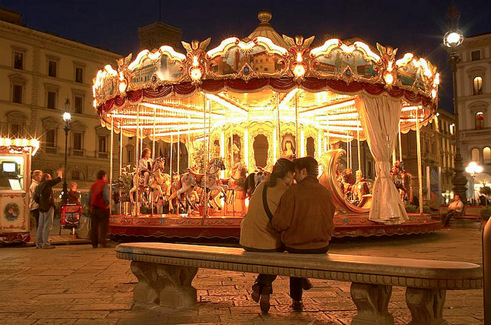 Lovers, carousel at night, Florence, Italy by Robert Crum
